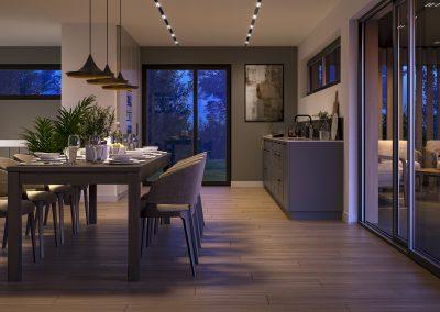 En fin, åpen løsning mellom stue og kjøkken som øker romfølelsen.